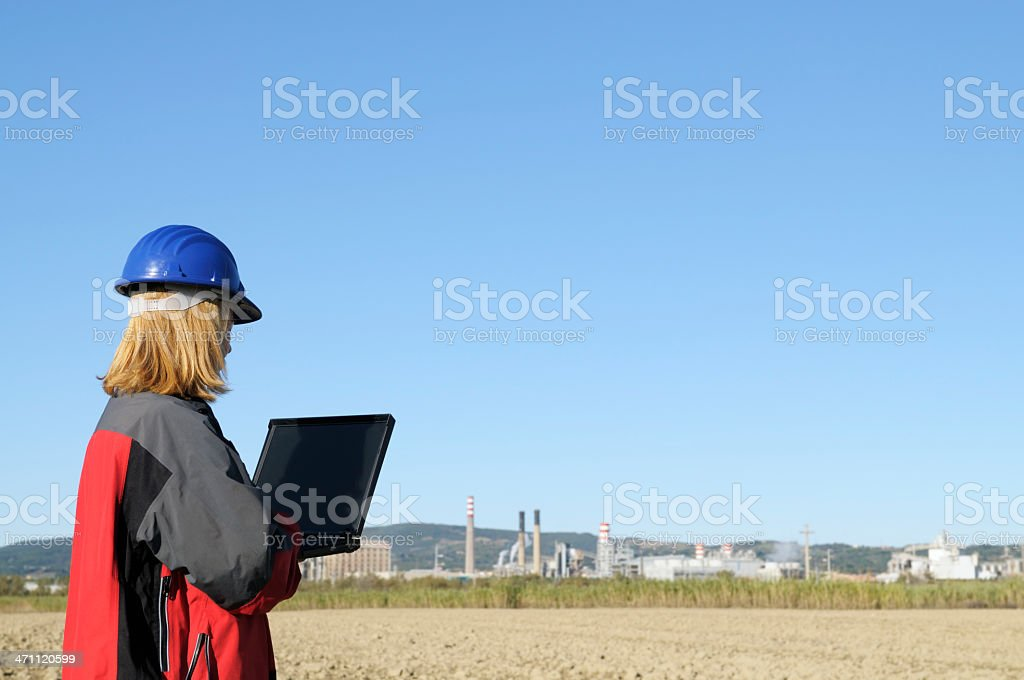 Female Engineer Planning PC and Oil Industry.Copy Space stock photo