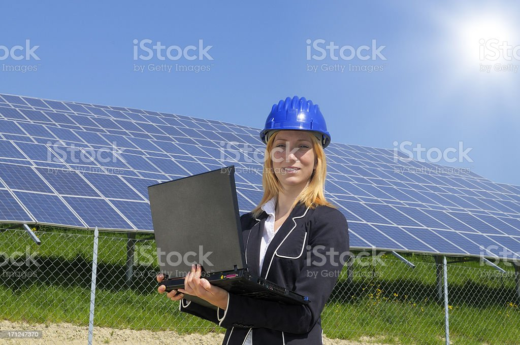 Female Engineer Planning PC and Solar Panel royalty-free stock photo