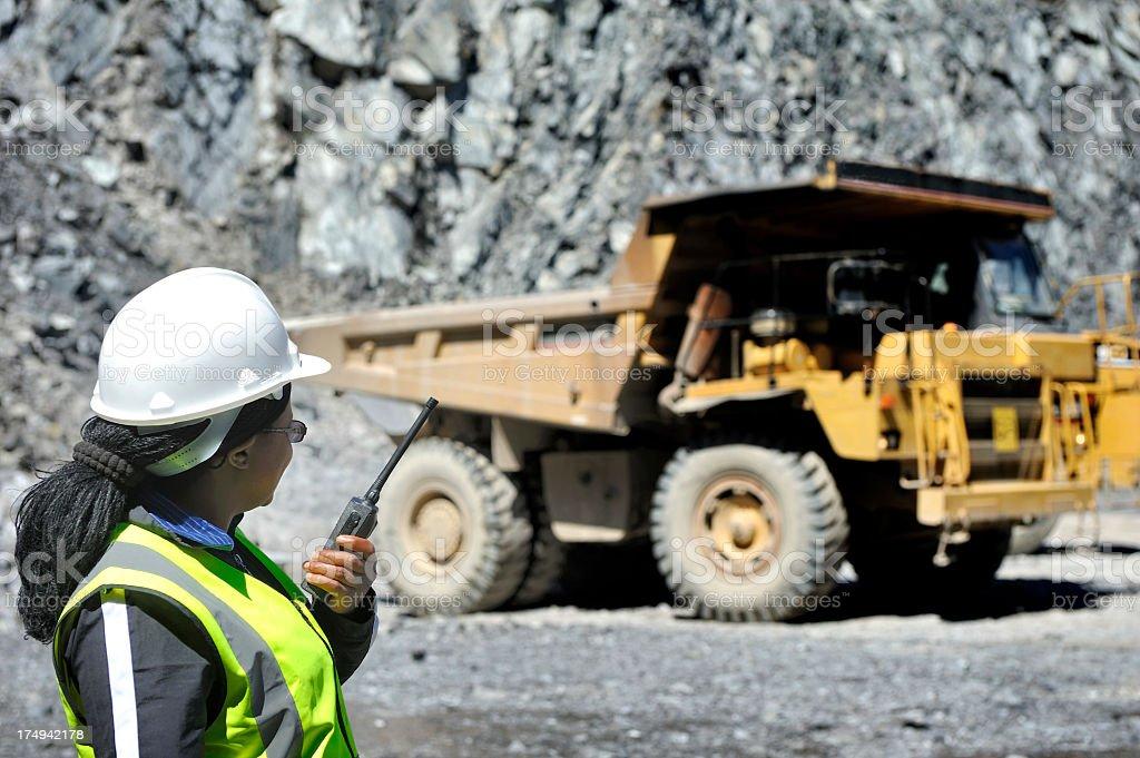 Female engineer supervises open pit mining stock photo