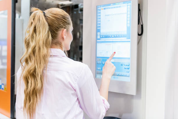 female engineer touch screen & industrial machine - interactivity stock photos and pictures