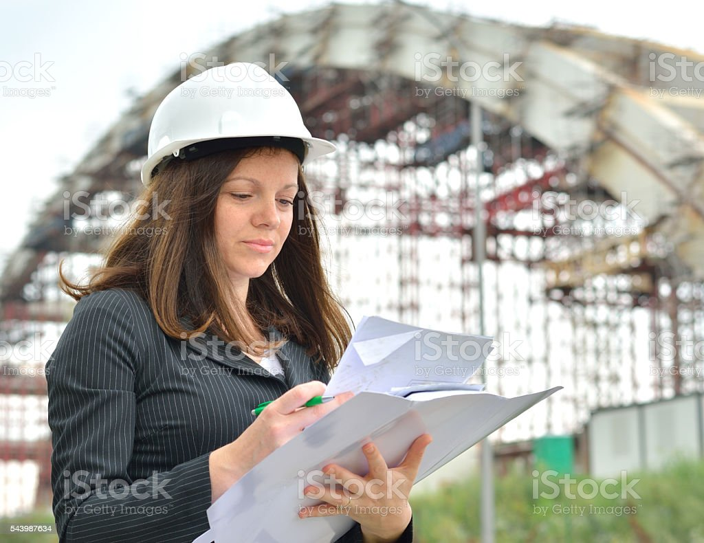 Female Engineer with Plans and Hardhat stock photo
