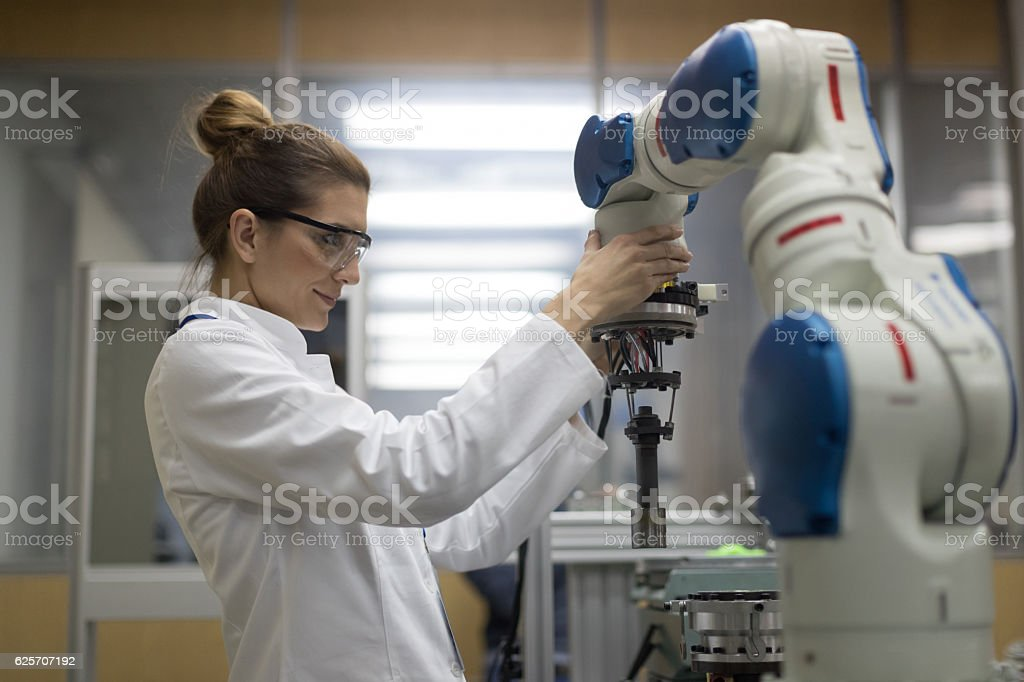 Female engineers working with robotic arm bildbanksfoto