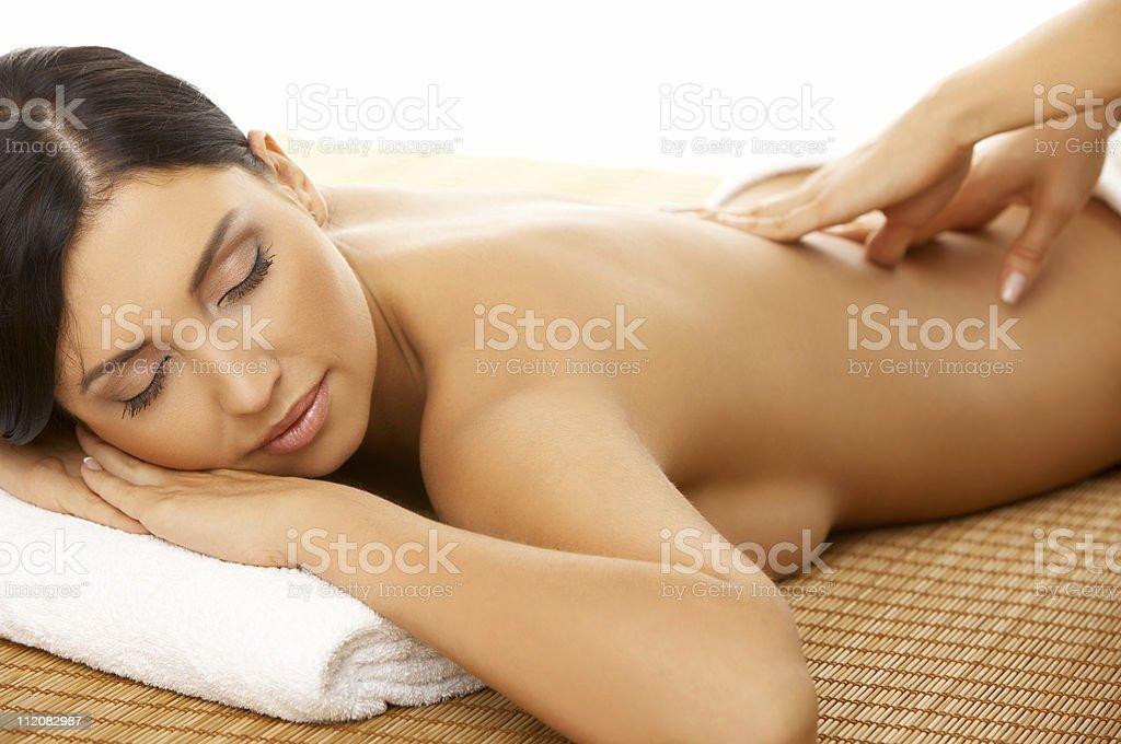 Female enjoying a back massage at a spa royalty-free stock photo