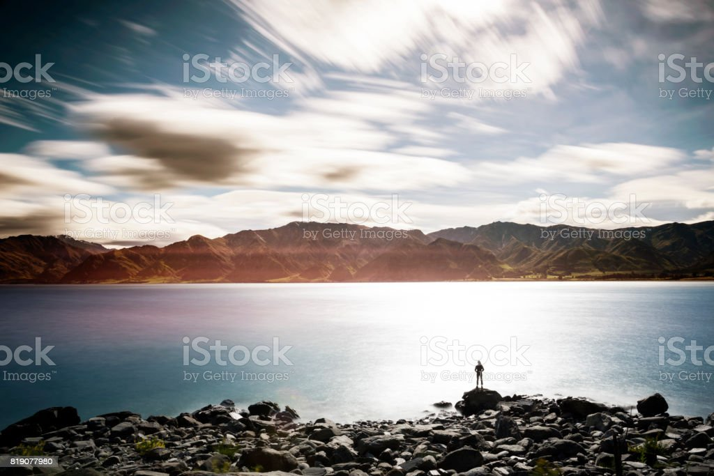 Female enjoying the view from the side of the lake - foto stock