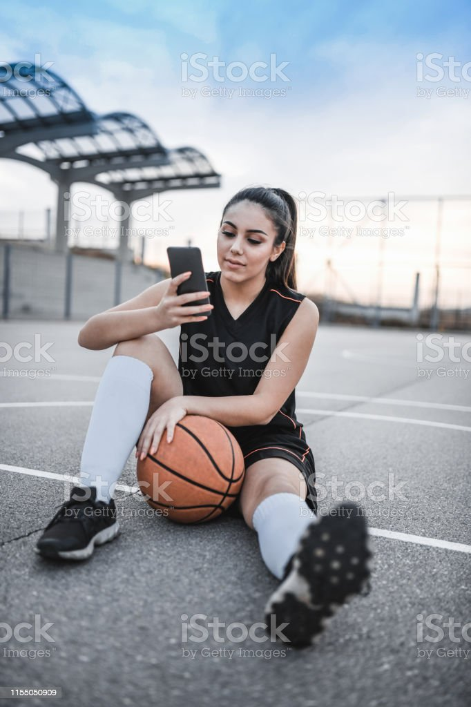 Female Enjoying Video Conference After Basketball Training
