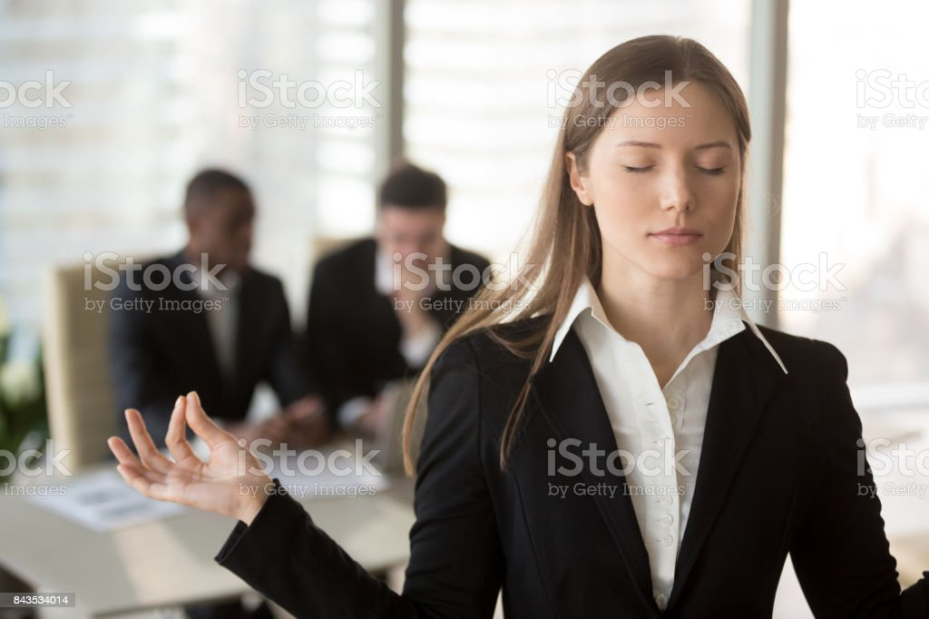 Female entrepreneur controlling emotions at work stock photo