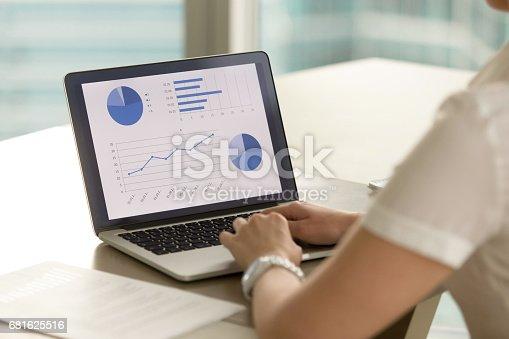 istock Female entrepreneur examines financial results 681625516
