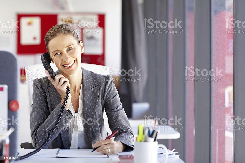 Female Entrepreneur On The Phone stock photo