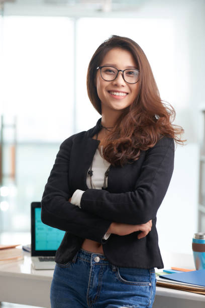 Female entrepreneur Portrait of cheerful pretty Vietnamese entrepreneur vietnamese ethnicity stock pictures, royalty-free photos & images