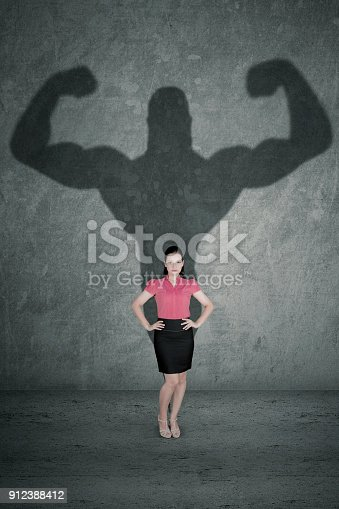 istock Female entrepreneur with her strong shadow 912388412