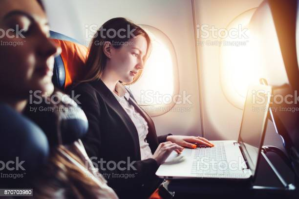 Female entrepreneur working on laptop sitting near window in an picture id870703980?b=1&k=6&m=870703980&s=612x612&h=ruxn6cp6 ug8qhubegwpf0r mtmxzefqr 1edegamik=
