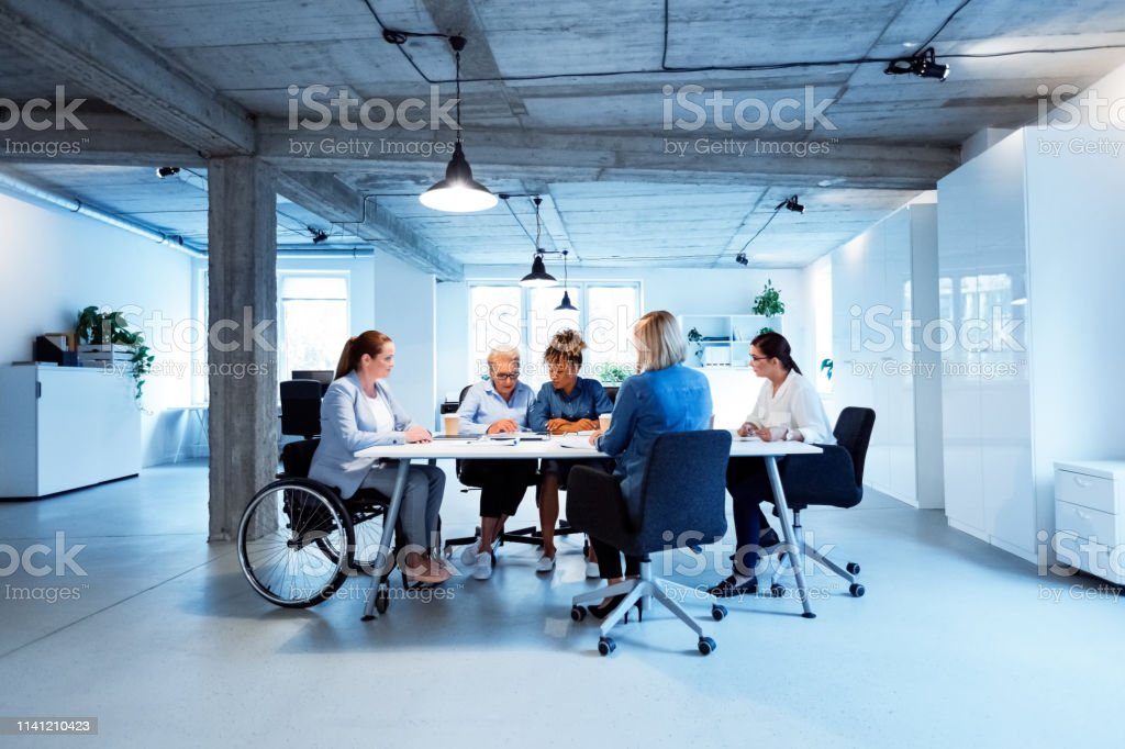 Female entrepreneurs having meeting in new office Female entrepreneurs having meeting in new office. Executives are planning new business strategies. They are working at desk. 35-39 Years Stock Photo