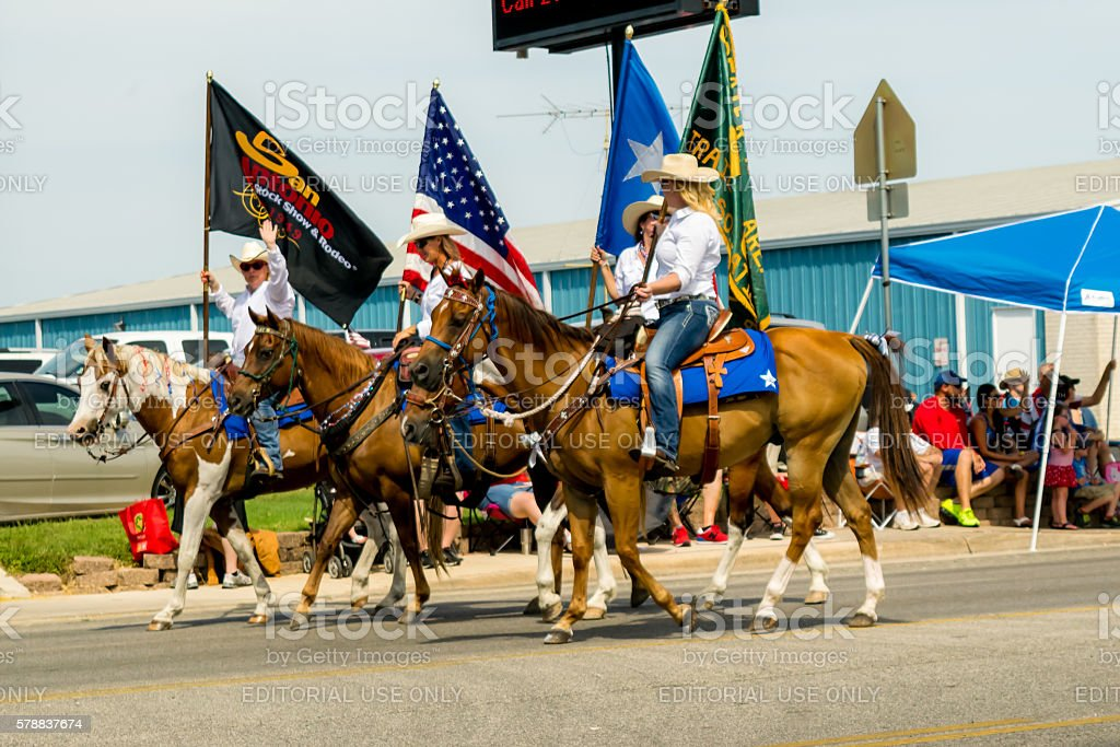 Female Equestrians In Fourth Of July Parade stock photo