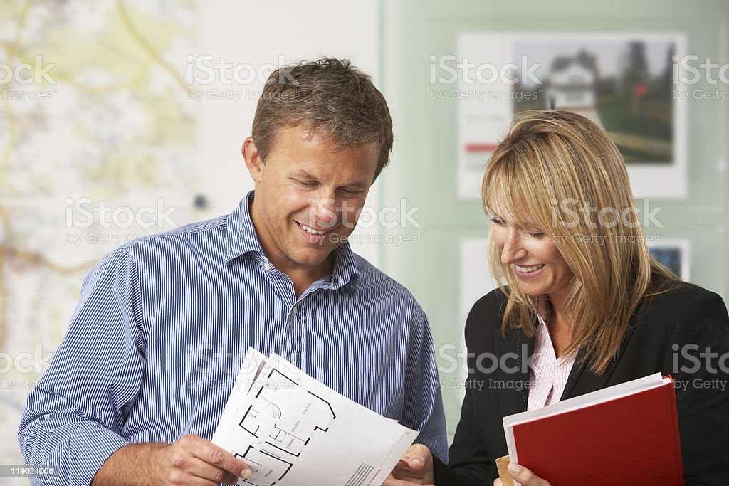 Female Estate Discussing Property Details With Client royalty-free stock photo