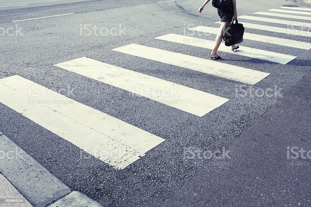 Female executive at pedestrian crossing royalty-free stock photo