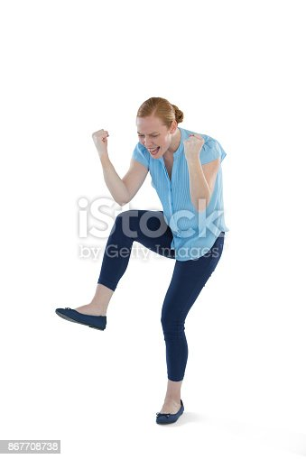 istock Female executive dancing against white background 867708738