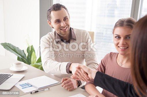 istock Female executive handshaking male service supplier, seo marketing optimization deal 680437336