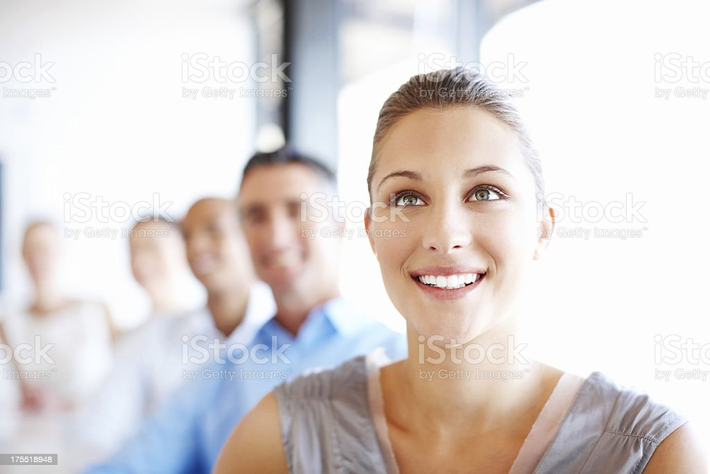 Female Executive In Staff Meeting stock photo