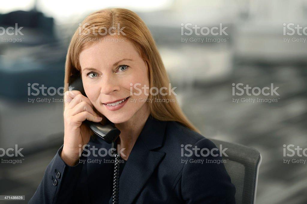 Female executive on the phone stock photo