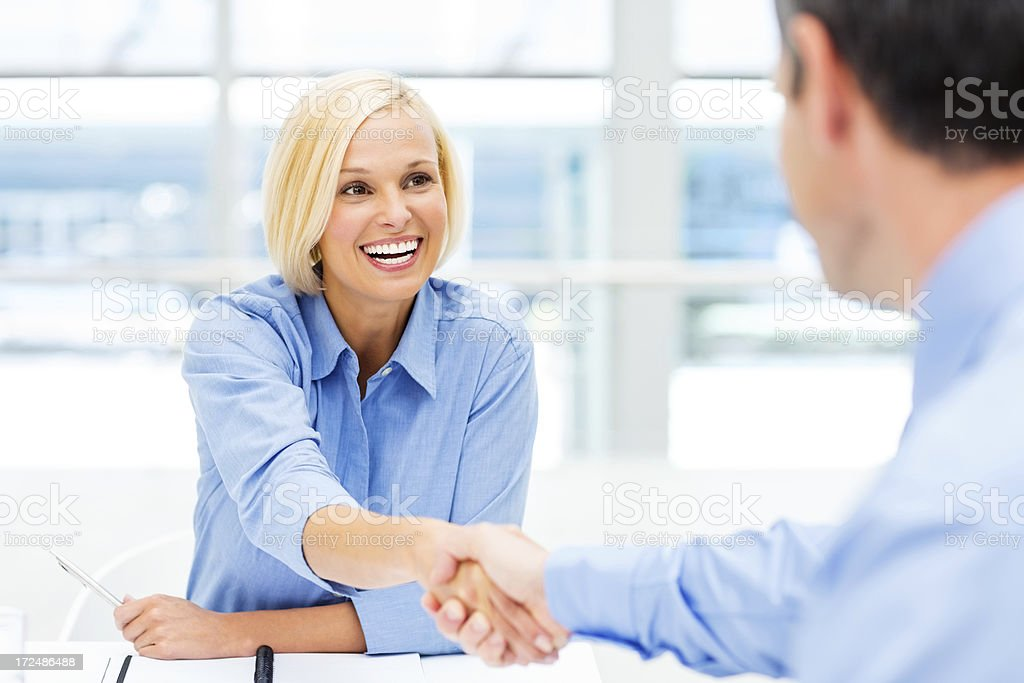 Female Executive Shaking Hands With Associate royalty-free stock photo
