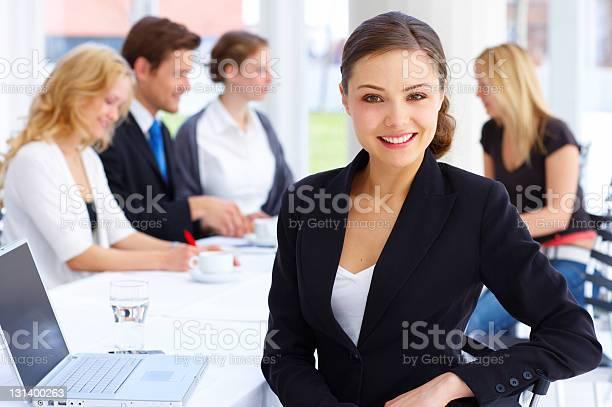 Female executive smiling Female executive smiling Adult Stock Photo