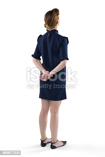 istock Female executive standing against white background 869872330