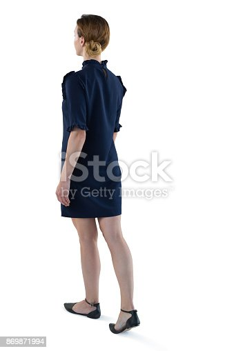istock Female executive walking against white background 869871994