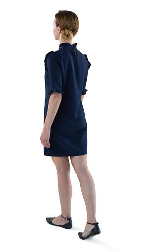istock Female executive walking against white background 869871994