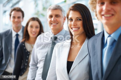 465474428istockphoto Female executive with colleagues 183429529