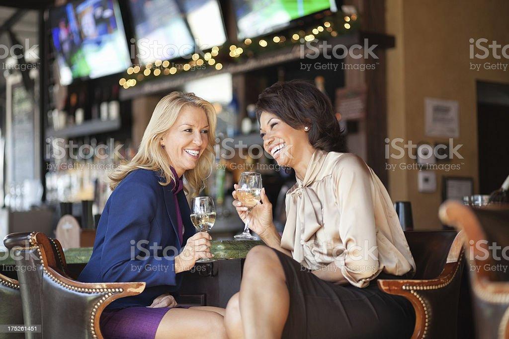 Female Executives Enjoying Drinks royalty-free stock photo