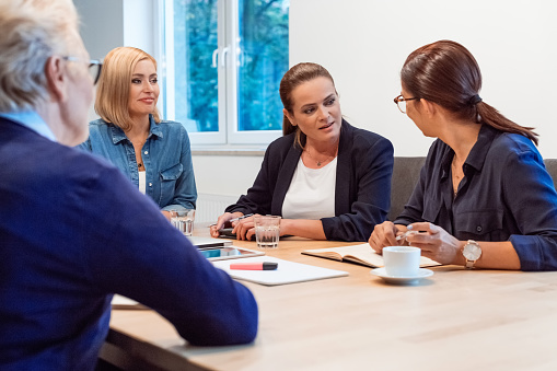Female Executives Planning Strategy In Office Stock Photo - Download Image Now