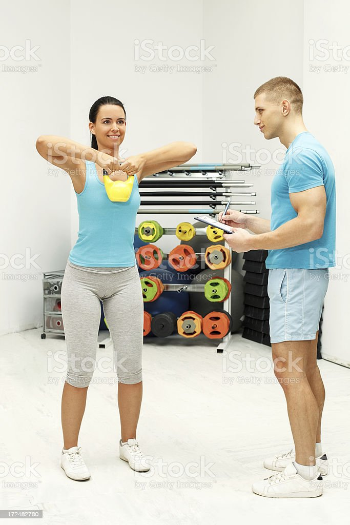 female exercises with kettle bell royalty-free stock photo
