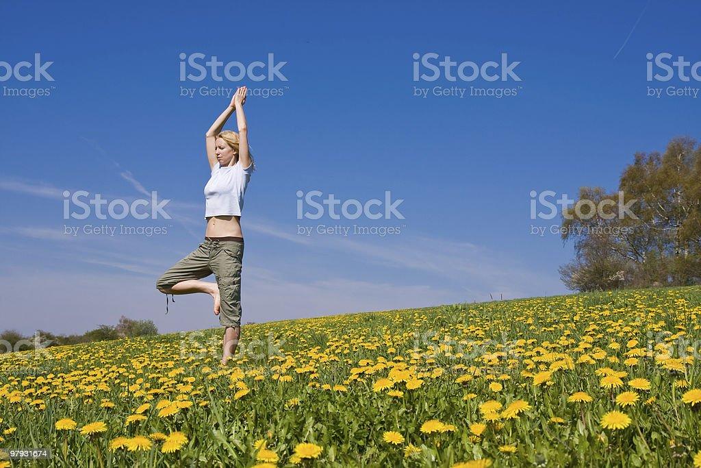 female exercising yoga royalty-free stock photo