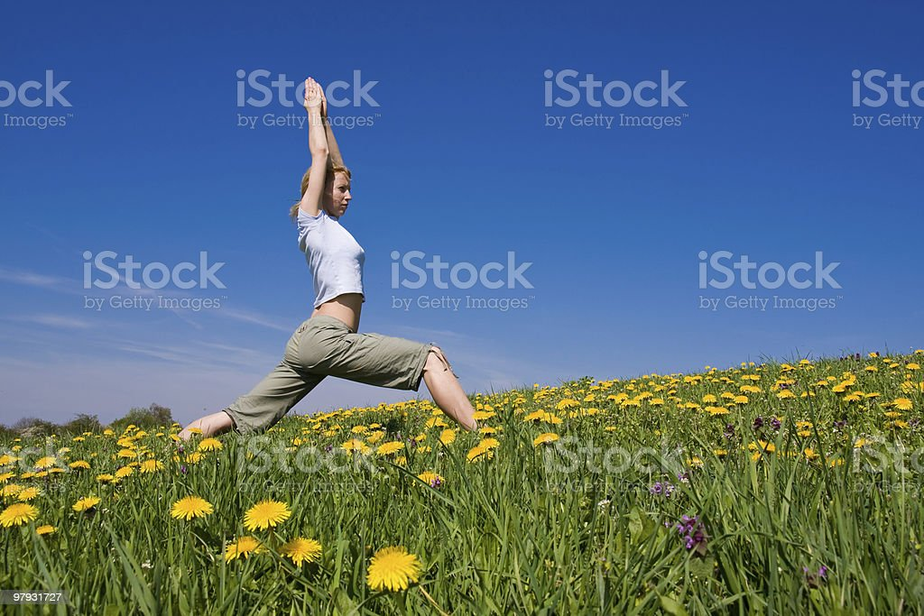 female exercising yoga royalty-free stock photo