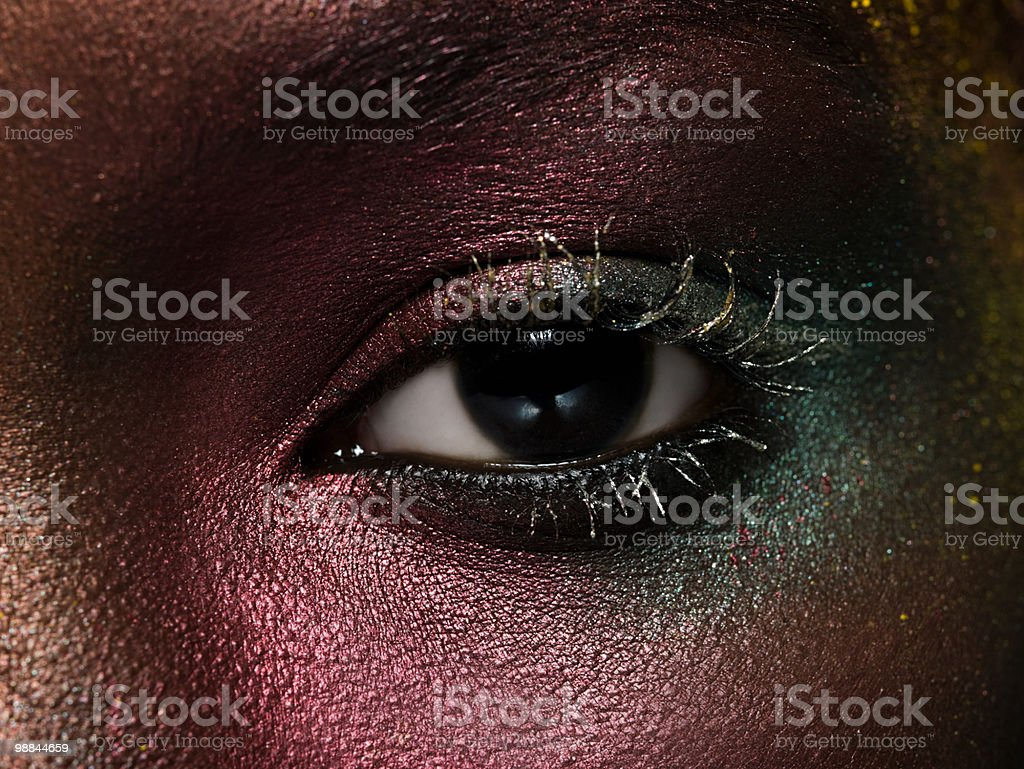 Female eye covered in metallic make up royalty-free stock photo