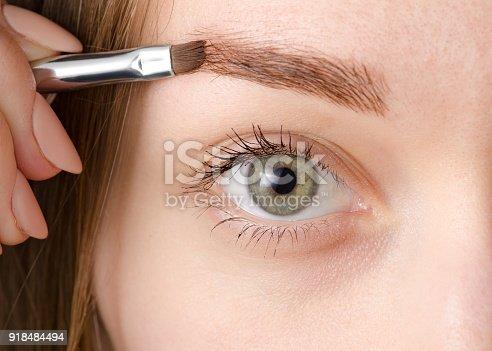 istock Female eye natural brush for painting eyebrow 918484494