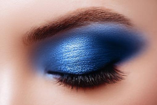 istock Female Eye with Extreme Long False Eyelashes. Eyelash Extensions. 1192672855