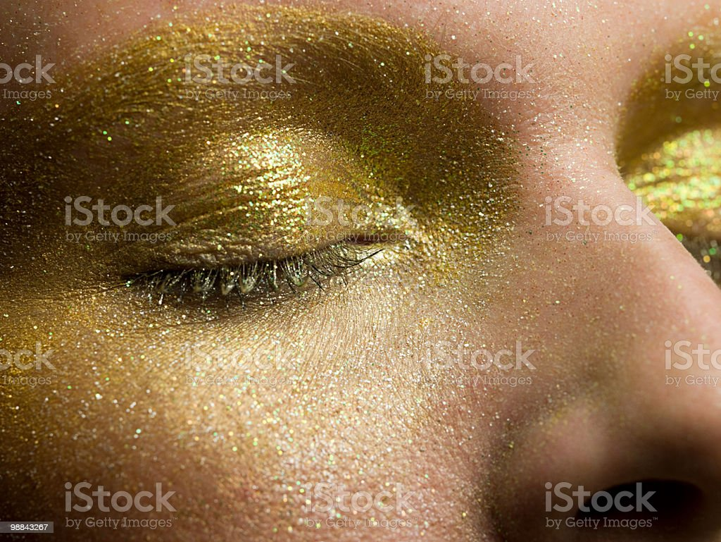 Female eyes covered in gold make up 免版稅 stock photo
