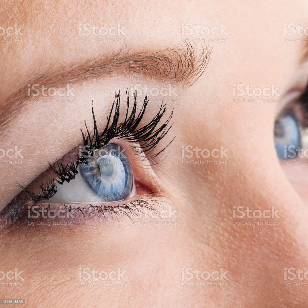 Female eyes macro stock photo