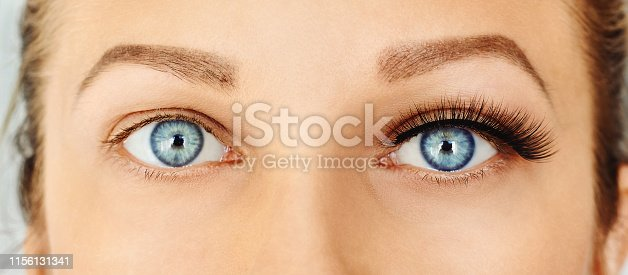Eyelash extensions, make-up, cosmetics concept. Close up
