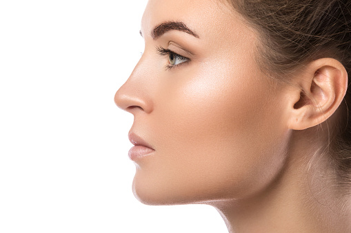 Female face in profile on white background