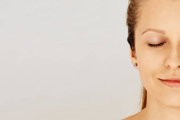 Female face with closed eyes and perfect skin with natural make-up stock photo