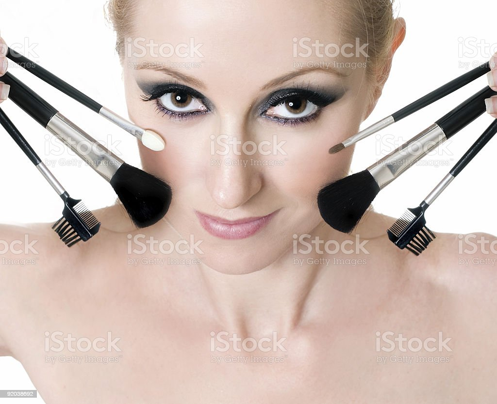 Female face with cosmetic makeup brushes royalty-free stock photo