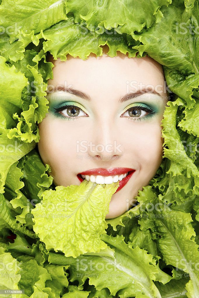 female face with green fresh lettuce leaves royalty-free stock photo