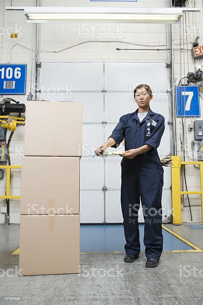 Female factory worker in a loading bay stock photo