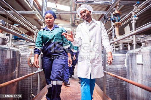 Africa, Work, Walking, Dairy Factory - Food Processing Plant Workers Walking Towards their Station