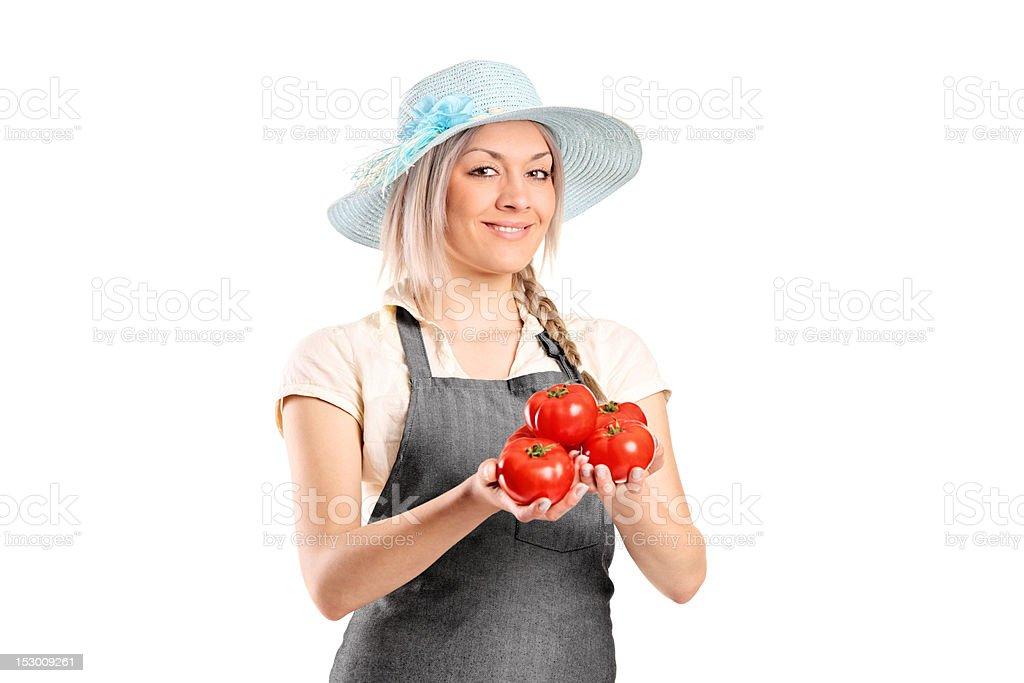 Female famer holding tomatoes royalty-free stock photo