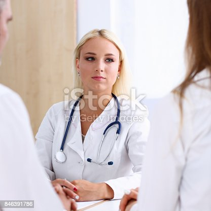 istock Female family doctor listen carefully young couple 846391786