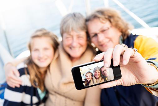 Female Family Members Taking Selfie on Sailing Yacht
