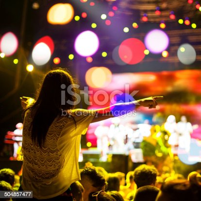 1069137774 istock photo Female fan at the concert 504857477